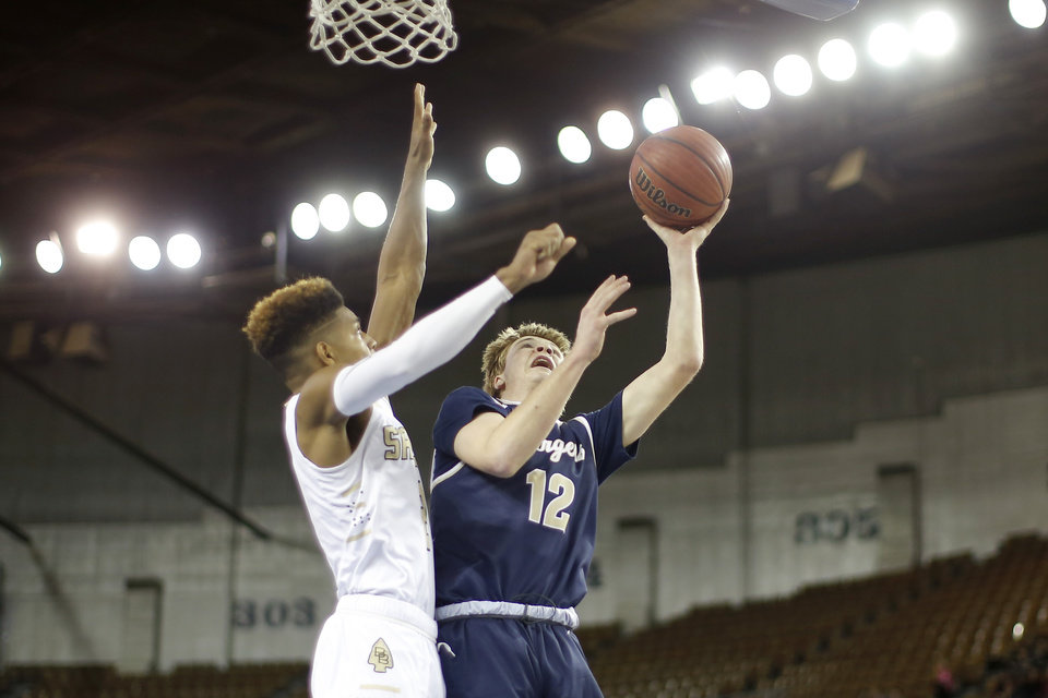 Photo - Heritage Hall's William McDonald goes to the basket beside Broken Bow's Tristian Polk during a Class 4A state tournament basketball game between Heritage Hall and Broken Bow High School in Jim Norick Arena at State Fair Park in Oklahoma City, Thursday, March 7, 2019. Photo by Bryan Terry, The Oklahoman