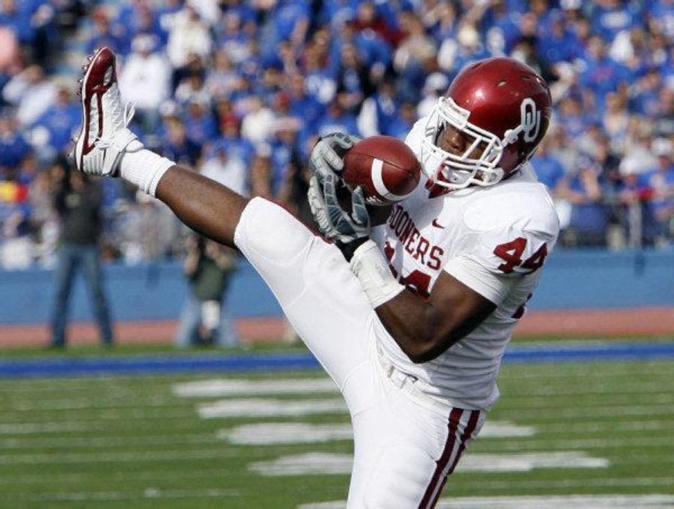 Photo - Jeremy Beal (44) make an interception against Kansas during the first half of the college football game between the University of Oklahoma Sooners (OU) and the University of Kansas Jayhawks (KU) on Saturday, Oct. 24, 2009, in Lawrence, Kan. Photo by Chris Landsberger, The Oklahoman ORG XMIT: KOD