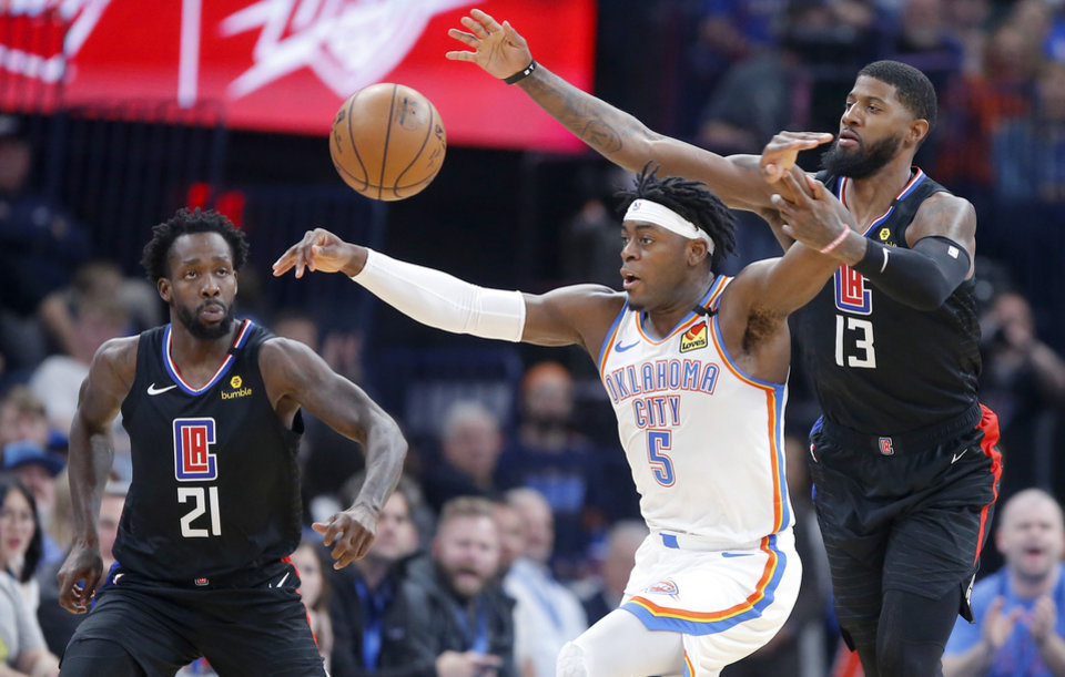 Photo - LA's Paul George (13) fouls Oklahoma City's Luguentz Dort (5) during an NBA basketball game between the Oklahoma City Thunder and the Los Angeles Clippers at Chesapeake Energy Arena in Oklahoma City, Tuesday, March 3, 2020. [Bryan Terry/The Oklahoman]