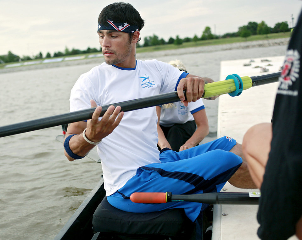 Photo - Paralympic Rower Tony Davis, gets his oars into place as he practices with rowing partner Jacqui Kapinowski on the Oklahoma River in Oklahoma City on Tuesday, June 14, 2011. Photo by John Clanton, The Oklahoman