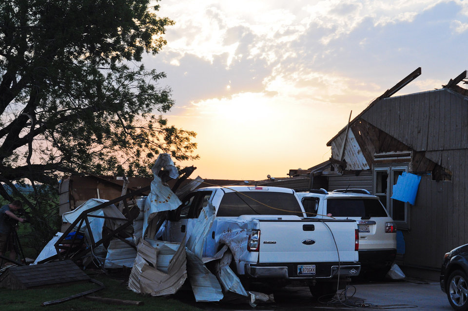 Photo - A piece of sheet metal is wrapped around a Ford F-150 truck at the house of Ida Clark after a tornado tore through Carney, Okla. on May 19, 2013.  KT King/For the Oklahoman