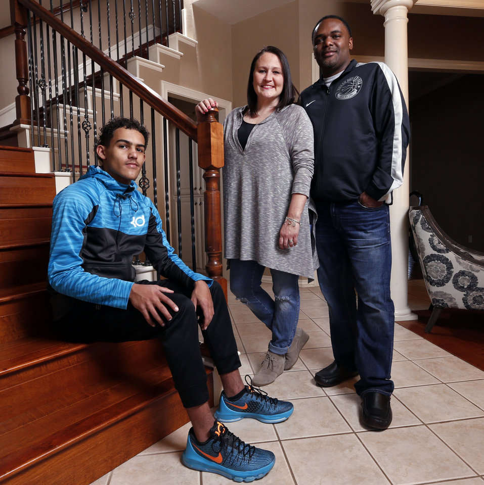 Photo - Norman North basketball player Trae Young poses with his father Ray and mother Candice on Wednesday, Jan. 27, 2016, in Norman, Okla.  Photo by Steve Sisney, The Oklahoman