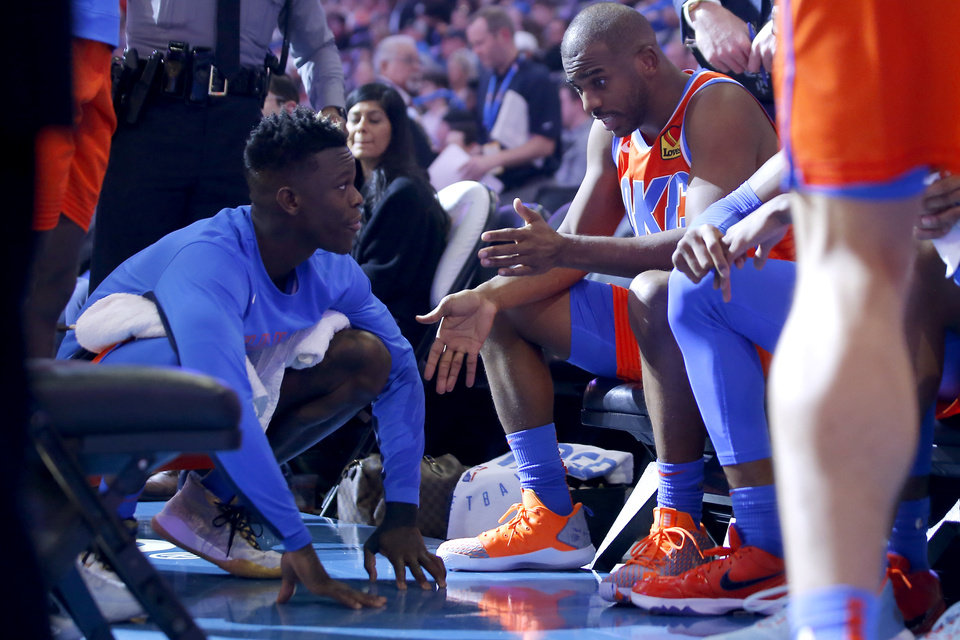 Photo - Oklahoma City's Chris Paul and Dennis Schroder, left, talk during a timeout in an NBA basketball game between the Oklahoma City Thunder and the LA Clippers at Chesapeake Energy Arena in Oklahoma City, Sunday, Dec. 22, 2019. Oklahoma City won 118-112. [Bryan Terry/The Oklahoman]