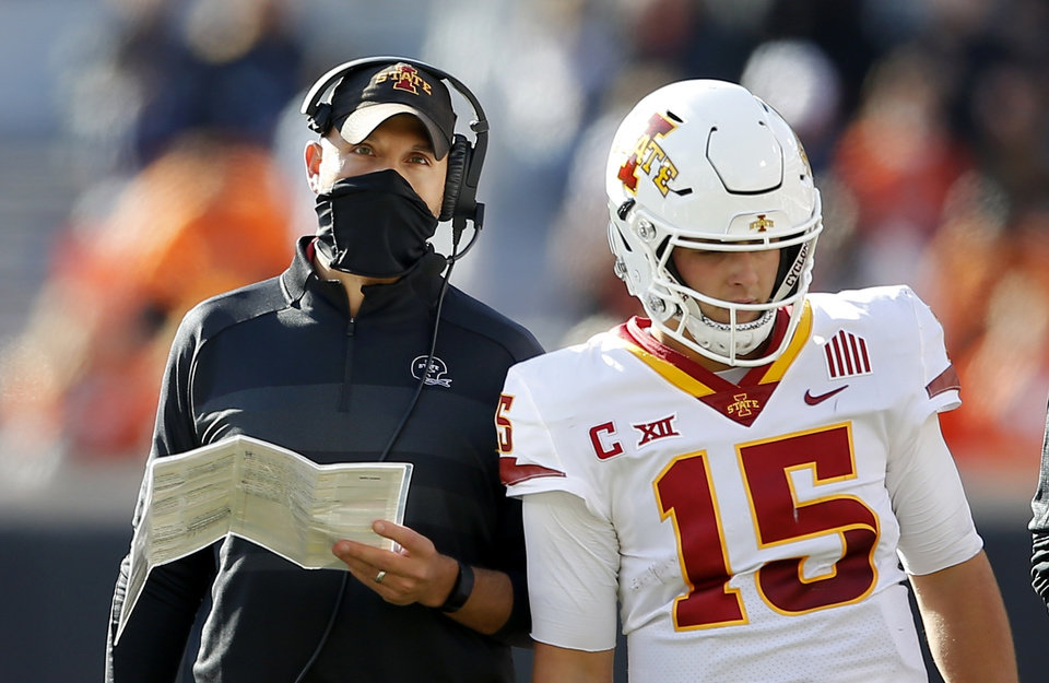 Photo -  Iowa State head coach Matt Campbell talks with quarterback Brock Purdy during a 24-21 loss at Oklahoma State on Oct. 24. [Sarah Phipps/The Oklahoman]