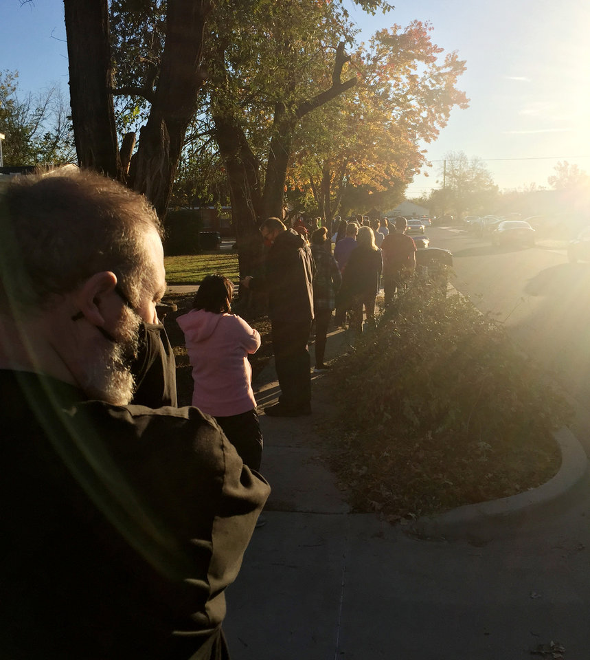 Photo - Voters lineup early Tuesday morning outside Berry Road Baptist Church in Norman. [Tim Willert/The Oklahoman]