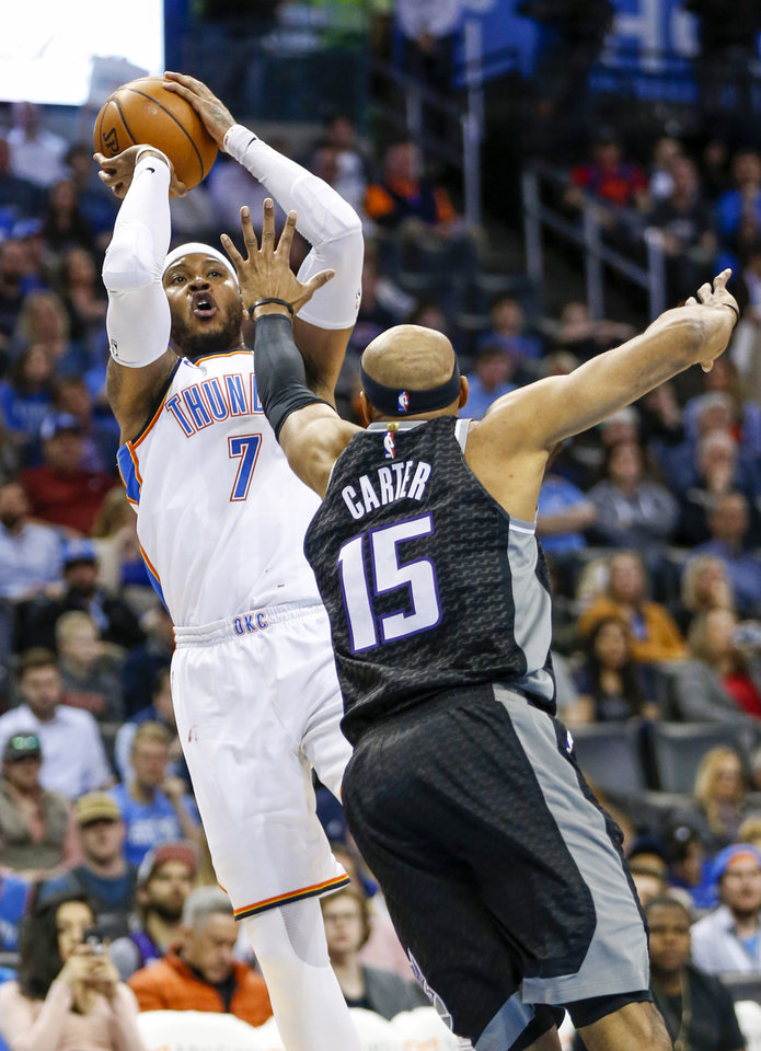 Photo - Oklahoma City's Carmelo Anthony (7) shoots against Sacramento's Vince Carter (15) during an NBA basketball game between the Oklahoma City Thunder and the Sacramento Kings at Chesapeake Energy Arena in Oklahoma City, Monday, March 12, 2018. Photo by Nate Billings, The Oklahoman