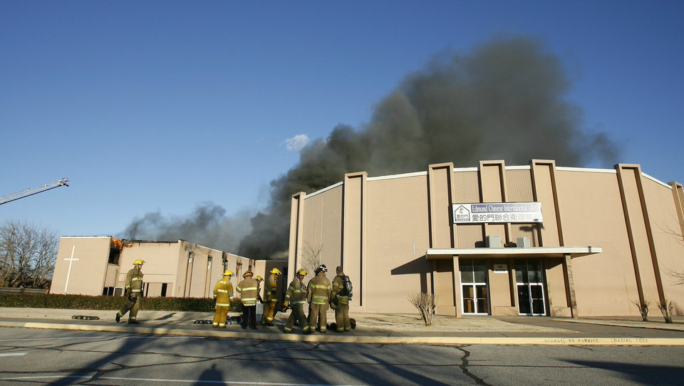 Photo - Edmond firefighters watch a fire at an annex building at New Covenant United Methodist Church at 2300 S Boulevard in Edmond. BY BRYAN TERRY, THE OKLAHOMAN ORG XMIT: KOD
