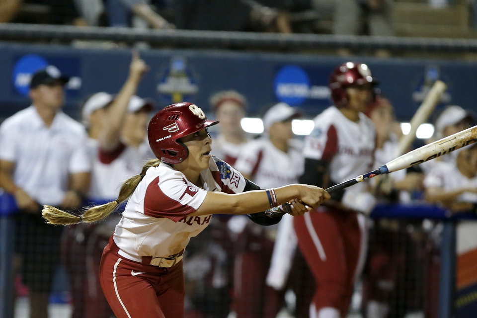 Photo - Oklahoma's Sydney Romero (2) hits a triple in the third inning of the fourth game of the Women's College World Series between the University of Oklahoma (OU) and Alabama at USA Softball Hall of Fame Stadium in Oklahoma City, Thursday, May 30, 2019. [Bryan Terry/The Oklahoman]