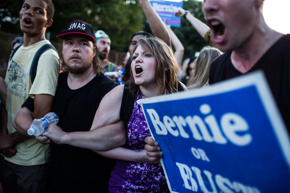 Photo - Supporters of former Democratic presidential candidate, Sen. Bernie Sanders, I-Vt., protest during the second day of the Democratic National Convention in Philadelphia, Tuesday, July 26, 2016. (Sean Simmers/PennLive.com via AP)