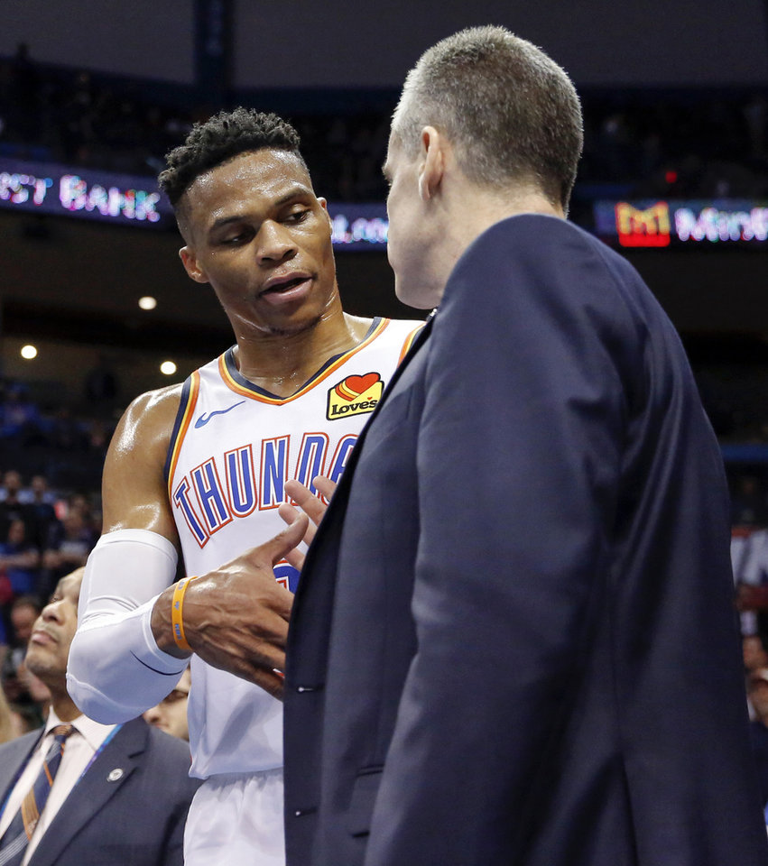 Photo - Oklahoma City's Russell Westbrook (0) and head coach Billy Donovan shake hands as the talk at the end of an NBA basketball game between the Los Angeles Lakers and the Oklahoma City Thunder at Chesapeake Energy Arena in Oklahoma City, Tuesday, April 2, 2019. Oklahoma City won 119-103. Photo by Nate Billings, The Oklahoman