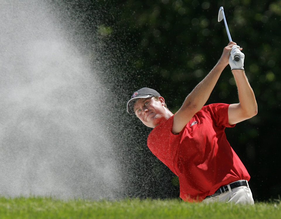 Photo - Georgia's Harris English hits out of a bunker on No. 14 during the team match final of the NCAA Division I Men's Golf Championship at Karsten Creek Golf Course in Stillwater, Okla., Sunday, June 5, 2011.  Augusta State beat Georgia, 3-2. Photo by Nate Billings, The Oklahoman
