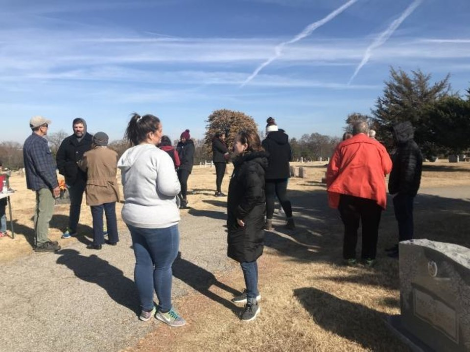 Photo -  People of different faiths talk together at the end of the Save A Cemetery project at Trice Hill Cemetery, 5101 N Coltrane. [Carla Hinton/The Oklahoman]