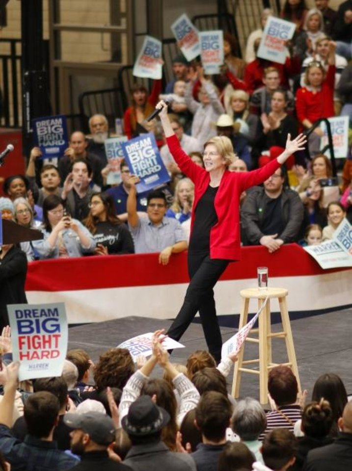 Photo -  An estimated 2,200 people listen to Democratic presidential candidate Elizabeth Warren during a campaign stop Sunday at Northwest Classen High School. [Doug Hoke/The Oklahoman]