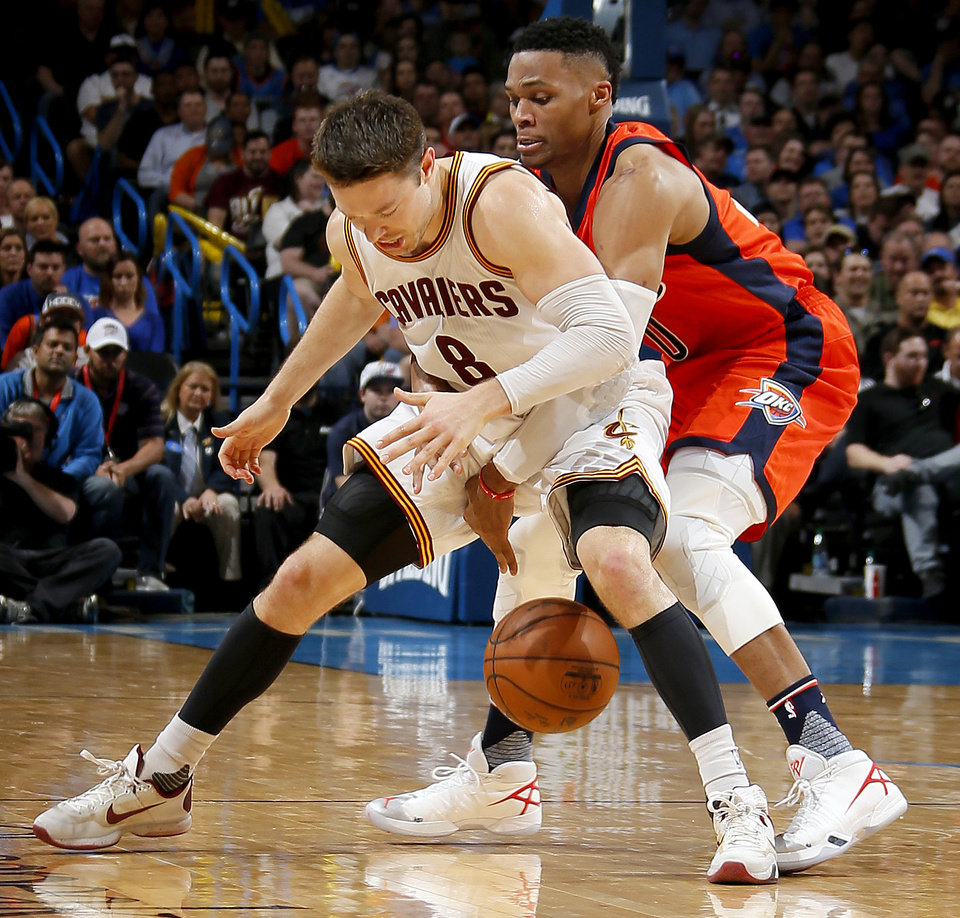 Photo - Oklahoma City's Russell Westbrook (0) fouls Cleveland's Matthew Dellavedova (8) during an NBA basketball game between the Oklahoma City Thunder and the Cleveland Cavaliers at Chesapeake Energy Arena in Oklahoma City, Sunday, Feb. 21, 2016. Oklahoma City lost 115-92.  Photo by Bryan Terry, The Oklahoman