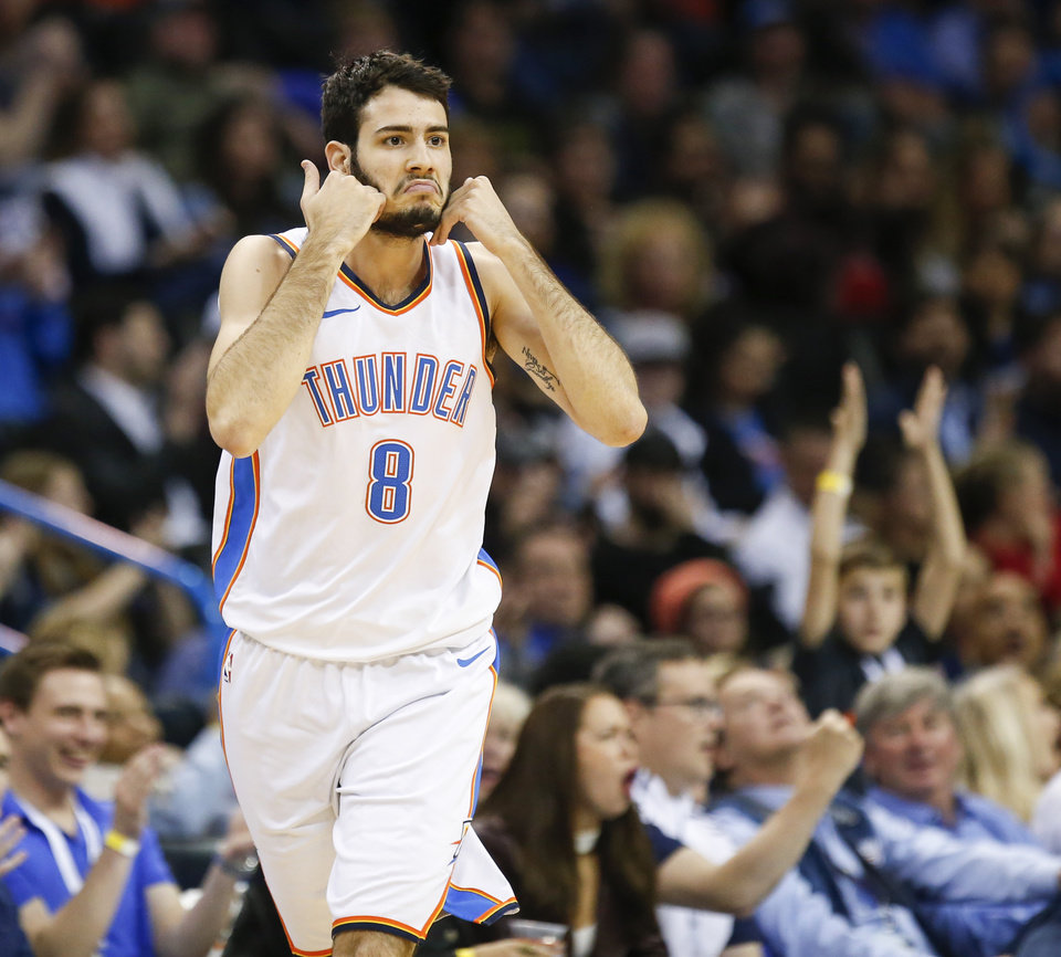 Photo - Oklahoma City's Alex Abrines (8) reacts after making a 3-point shot during an NBA basketball game between the Oklahoma City Thunder and the Sacramento Kings at Chesapeake Energy Arena in Oklahoma City, Monday, March 12, 2018. Oklahoma City won 106-101. Photo by Nate Billings, The Oklahoman