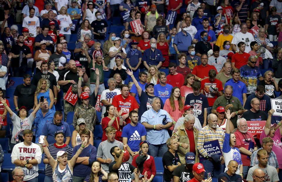 Photo - Supporters sing the National Anthem before President Donald Trump rally at the BOK Center in Tulsa, Okla., Saturday, June 20, 2020. [Sarah Phipps/The Oklahoman]
