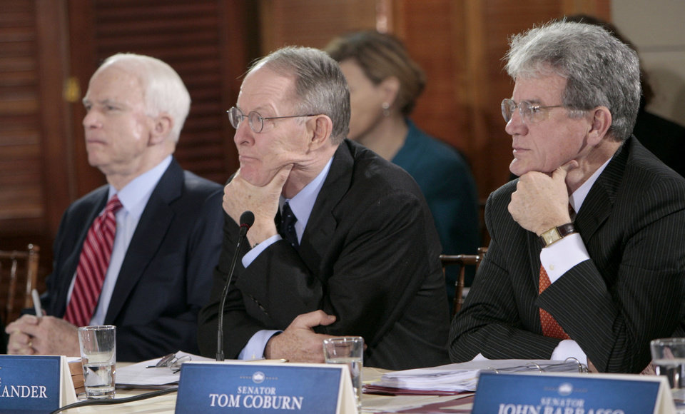Photo - From left, Sen. John McCain, R-Ariz., Sen Lamar Alexander, R-Tenn., and Sen. Tom Coburn, R-Okla., listen during the health care reform meeting at the Blair House in Washington, Thursday, Feb. 25, 2010. (AP Photo/Pablo Martinez Monsivais) ORG XMIT: DCPM121