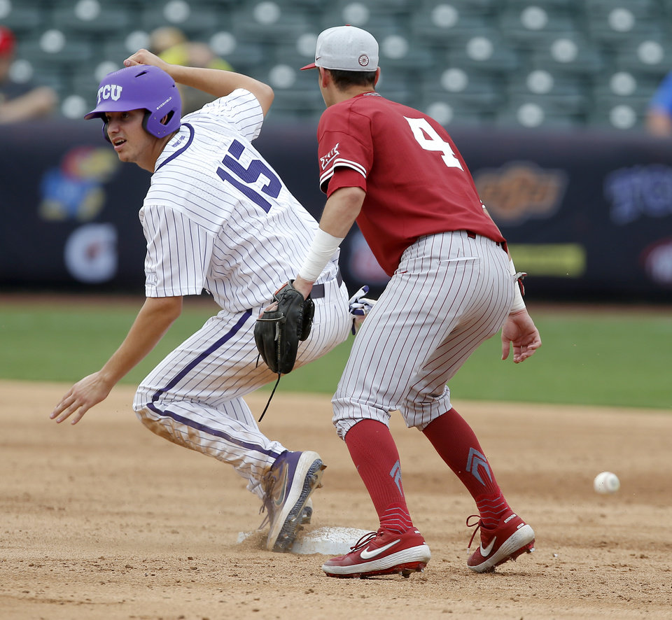 Photo - TCU's Andrew Keefer (15) advanes to second beside Oklahoma's Brandon Zaragoza in the fourth inning of a Big 12 baseball tournament game between the University of Oklahoma (OU) and TCU at Chickasaw Bricktown Ballpark in Oklahoma City, Okla., Thursday, May 23, 2019.  [Bryan Terry/The Oklahoman]