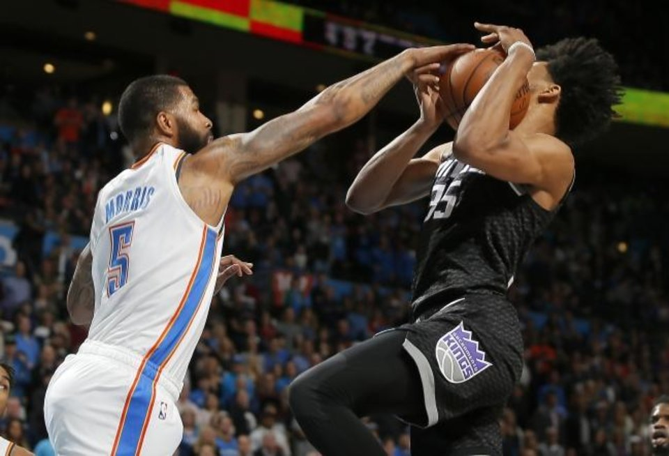 Photo -  Oklahoma City's Markieff Morris (5) defends Sacramento's Marvin Bagley III (35) during the Kings' 119-116 win Saturday at Chesapeake Energy Arena. [Bryan Terry/The Oklahoman]