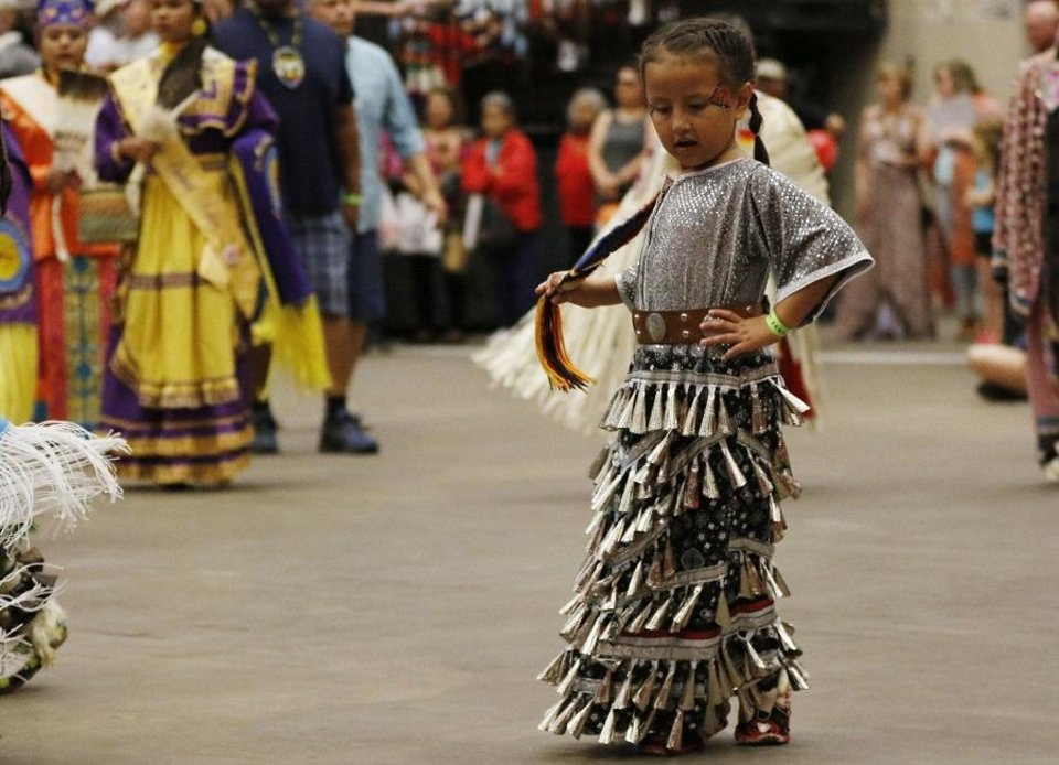 Photo - A jingle dress dancer performs at the 2019 Red Earth Festival at the Cox Convention Center in Oklahoma City, Oklahoma Saturday, June 8, 2019.  [Paxson Haws/The Oklahoman]