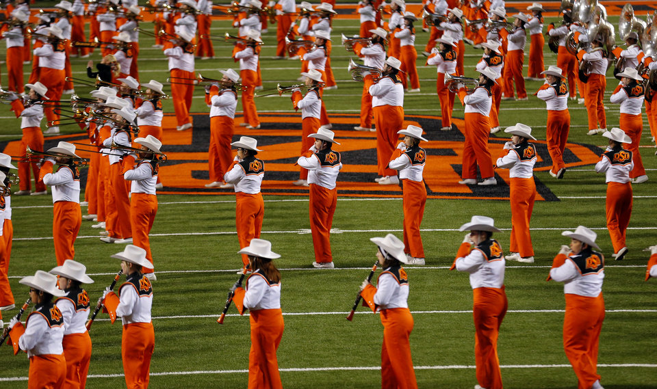 Photo - The Oklahoma State marching band performs at half time during the college football game between the Oklahoma State University Cowboys (OSU) the University of Texas Longhorns (UT) at Boone Pickens Staduim in Stillwater, Okla. on Saturday, Nov. 15, 2014.  Photo by Sarah Phipps, The Oklahoman