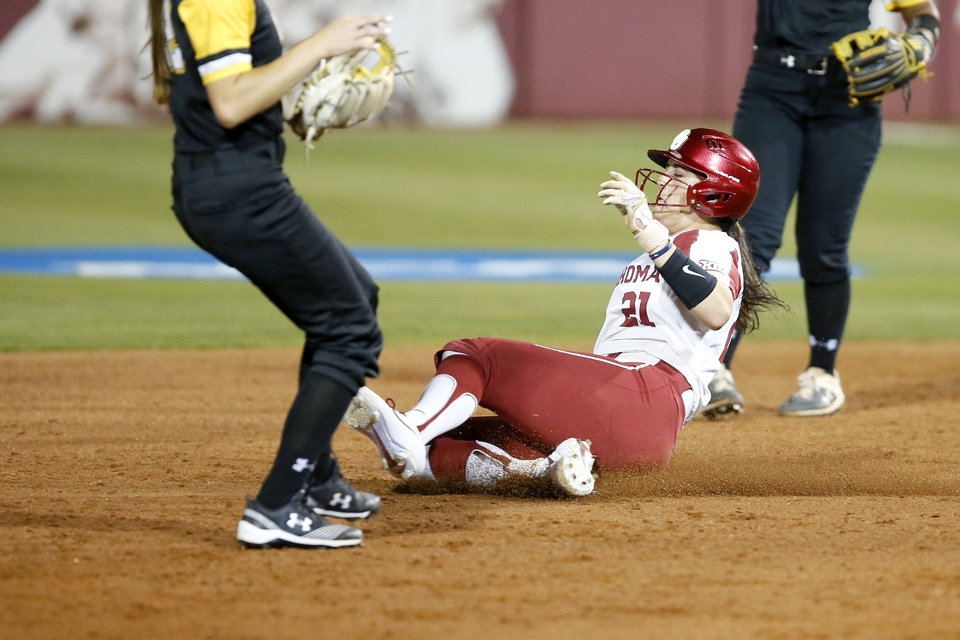 Photo - Oklahoma's Grace Green (21) slides to second base in third inning of the Norman Regional NCAA softball tournament game between the University of Oklahoma (OU) and UMBC in Norman, Okla., Friday, May 17, 2019. Oklahoma won 12-0.  [Bryan Terry/The Oklahoman]