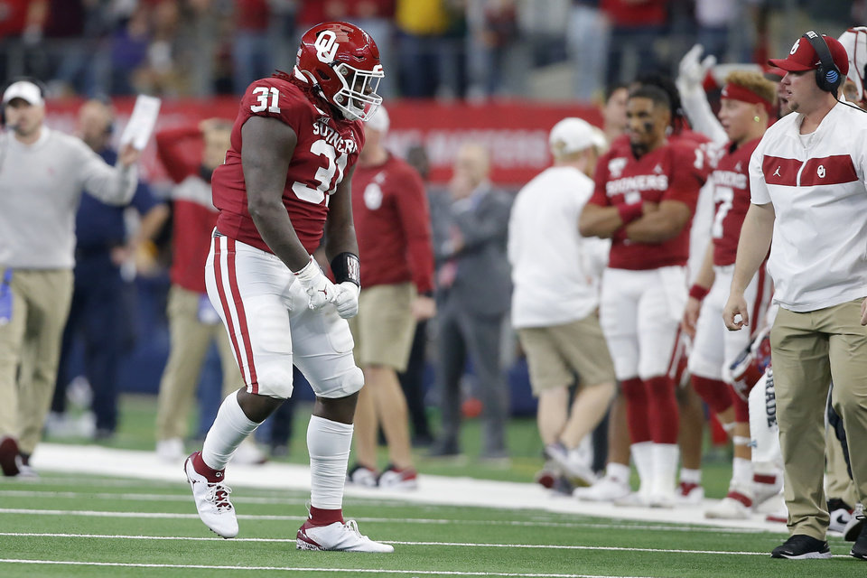 Photo - Oklahoma's Jalen Redmond (31) celebrates after a stop in overtime of the Big 12 Championship Game between the University of Oklahoma Sooners (OU) and the Baylor University Bears at AT&T Stadium in Arlington, Texas, Saturday, Dec. 7, 2019. Oklahoma won 30-23. [Bryan Terry/The Oklahoman]