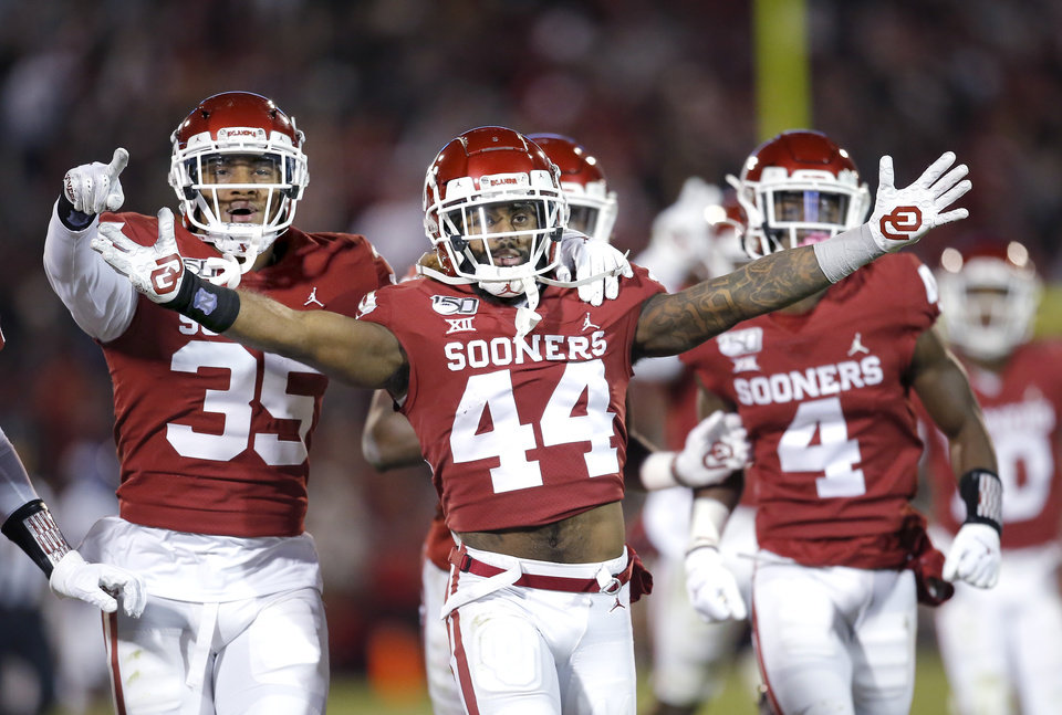 Photo - Oklahoma's Brendan Radley-Hiles (44) celebrates his interception late in the fourth quarter with Nik Bonitto (35) during an NCAA football game between the University of Oklahoma Sooners (OU) and the TCU Horned Frogs at Gaylord Family-Oklahoma Memorial Stadium in Norman, Okla., Saturday, Nov. 23, 2019. OU won 28-24. [Sarah Phipps/The Oklahoman]