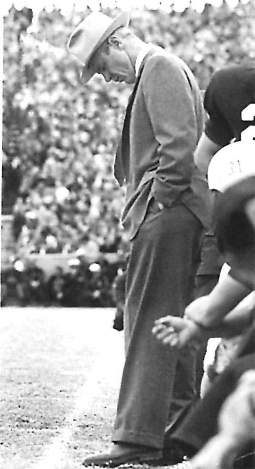 Photo - Bud Wilkinson, OU head football coach, hangs his head on the sideline during the Sooners 7-0 loss to Notre Dame on Nov. 16, 1957.  The loss ended OU's national record win streak at 47 games. (Oklahoman Archives)