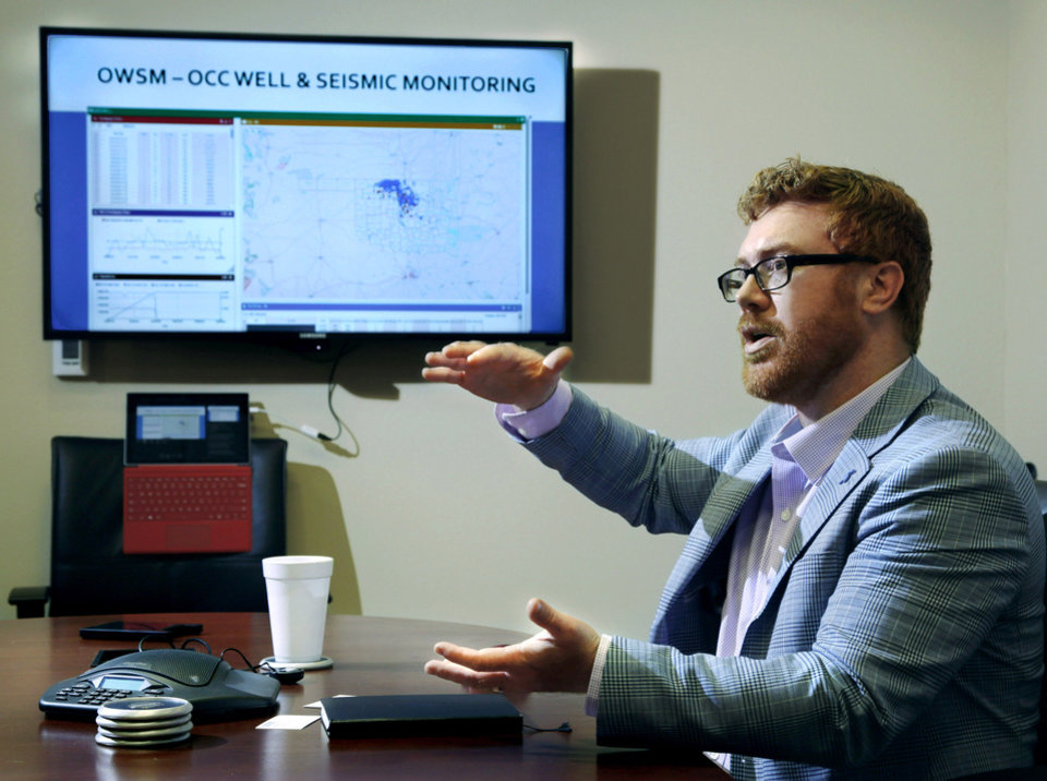 Photo -  Dan Yates, associate executive director of the Groundwater Protection Council, talks about the software development process for a data dashboard used to track earthquakes and disposal wells in Oklahoma. [PHOTO BY JIM BECKEL, THE OKLAHOMAN]