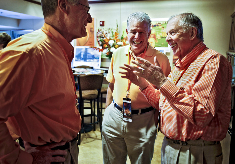 Photo - Boone Pickens, right, laughs as he talks with OSU president Burns Hargis, left, and John Niblack during game day of the Oklahoma State University Cowboys and the Grambling State University Tigers at Boone Pickens Stadium on Saturday, Sept. 26, 2009, in Stillwater, Okla.