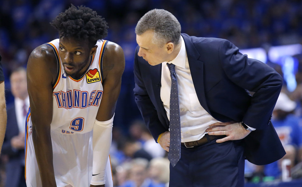 Photo - Oklahoma City head coach Billy Donovan talks with Jerami Grant (9) during Game 4 in the first round of the NBA playoffs between the Portland Trail Blazers and the Oklahoma City Thunder at Chesapeake Energy Arena in Oklahoma City, Sunday, April 21, 2019. Portland won 111-98. Photo by Sarah Phipps, The Oklahoman