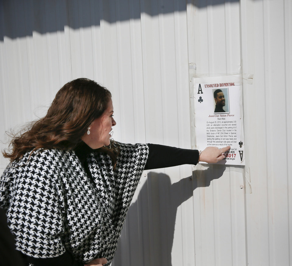 Photo - Sarah Burdine talks about her son, Jean-Ciar Pierce, while looking at a poster about his unsolved homicide near where he was killed in the 8400 block of NE 23 in Spencer, Okla., Friday, Jan. 24, 2020. [Nate Billings/The Oklahoman]