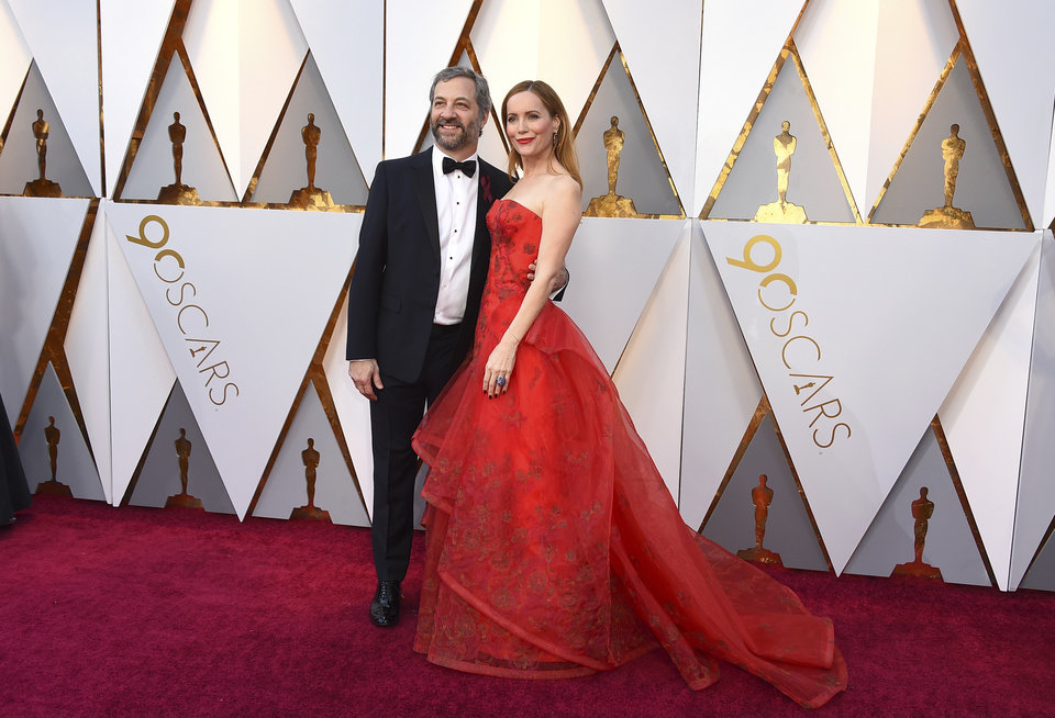 Photo - Judd Apatow, left, and Leslie Mann arrive at the Oscars on Sunday, March 4, 2018, at the Dolby Theatre in Los Angeles. (Photo by Jordan Strauss/Invision/AP)