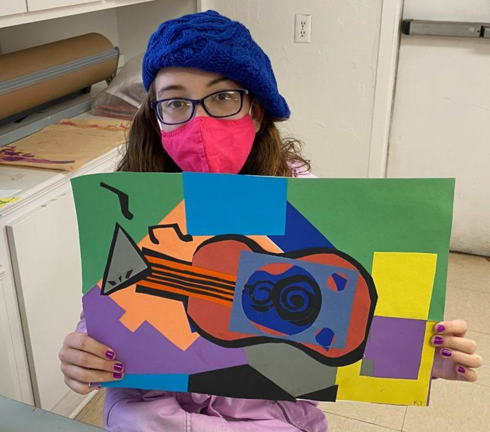 Photo - Students learn about cubism and Picasso's guitar constructions. [Firehouse Art Center]