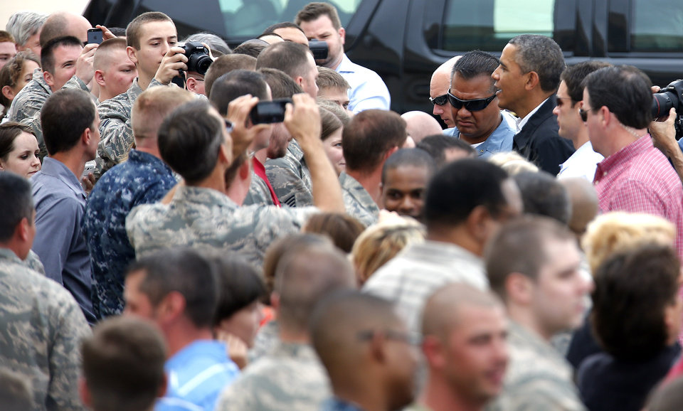 Photo - President Barack Obama greets guests at Tinker Air Force base in Midwest City, Sunday, May 26, 2013. Obama was in town to visit areas damaged by the May 20 tornado. Photo by Sarah Phipps, The Oklahoman