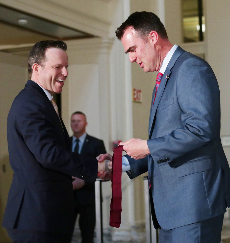 Photo - Jay Ferguson receives a Arts in Education Award from Governor Kevin Stitt at the Governor's Arts Awards at the Capitol, Tuesday, April 16, 2019. Photo by Doug Hoke/The Oklahoman