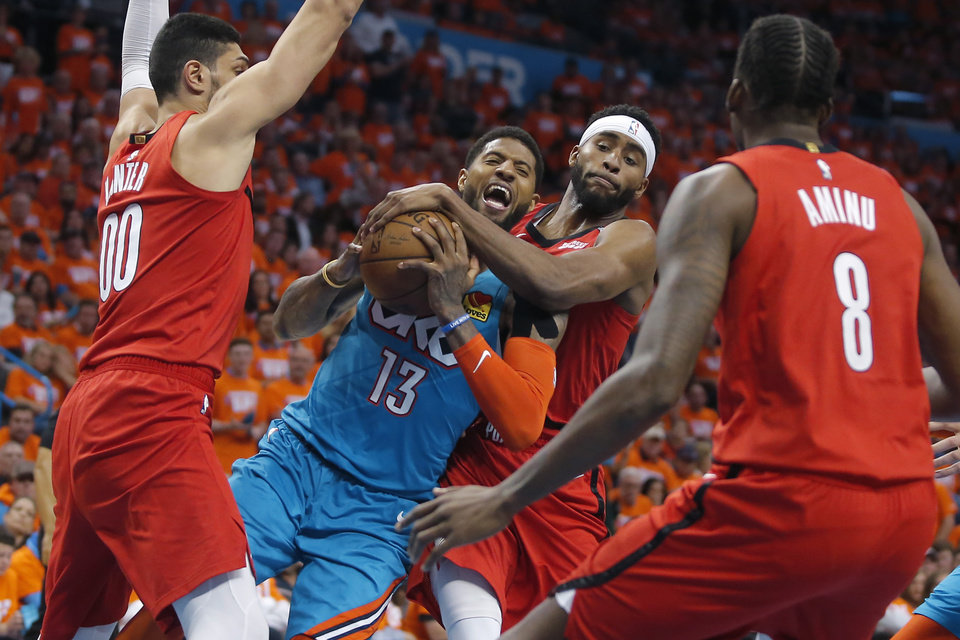 Photo - Oklahoma City's Paul George (13) tries to get past Maurice Harkless (4) during Game 3 in the first round of the NBA playoffs between the Portland Trail Blazers and the Oklahoma City Thunder at Chesapeake Energy Arena in Oklahoma City, Friday, April 19, 2019. Oklahoma City won 120-108. Photo by Bryan Terry, The Oklahoman