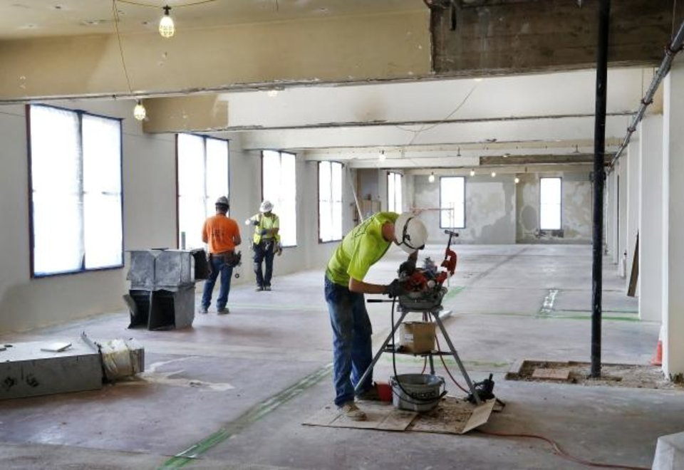 Photo -  Walls have been removed from the House office area and workers will erect new walls to encapsulate offices for the House speaker, his staffers and other members of the House. [Jim Beckel/The Oklahoman]