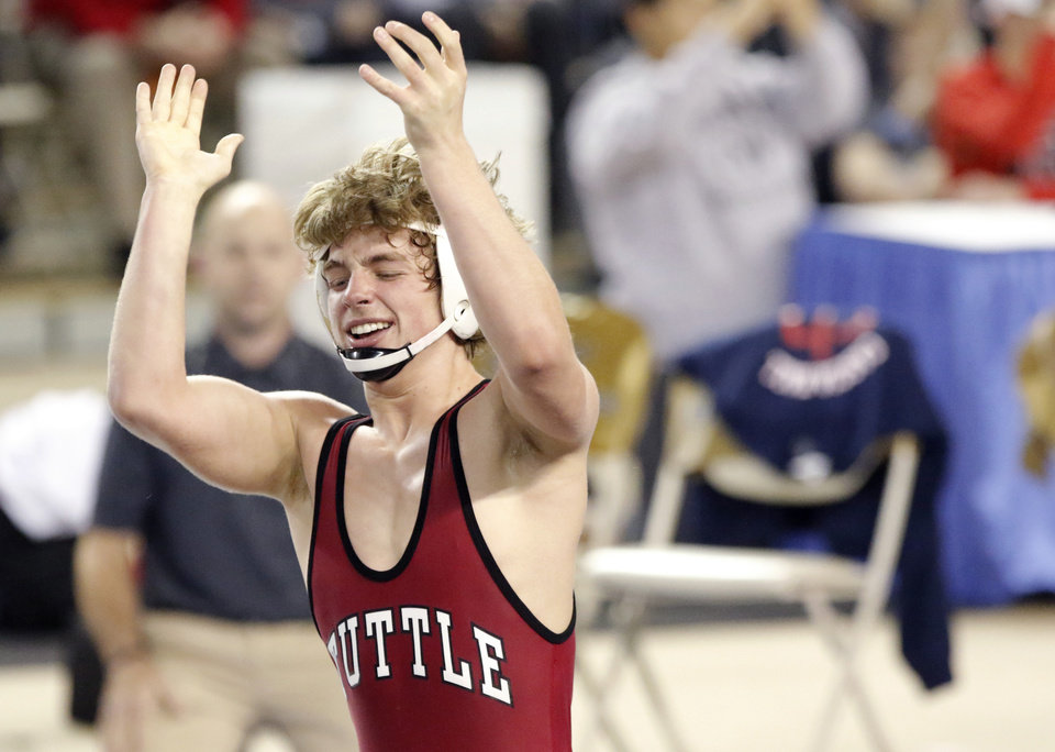 Photo - Tuttle's Carson Berryhill celebrates his win over Cascia Hall's Jake Hall in the 4A 160-pound match during the finals of the state high school championship wrestling tournament Jim Norick Arena at State Fair Park in Oklahoma City, Saturday, Feb. 25, 2017.  Photo by Sarah Phipps, The Oklahoman