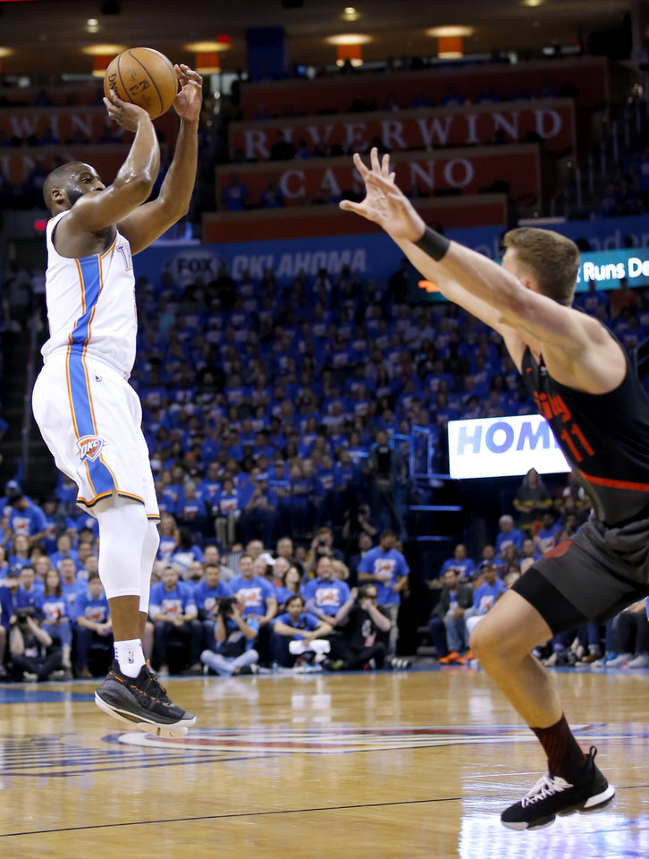 Photo - Oklahoma City's Raymond Felton (2) shoots a 3-point basket over Portland's Meyers Leonard (11) during Game 4 in the first round of the NBA playoffs between the Portland Trail Blazers and the Oklahoma City Thunder at Chesapeake Energy Arena in Oklahoma City, Sunday, April 21, 2019.  Photo by Sarah Phipps, The Oklahoman