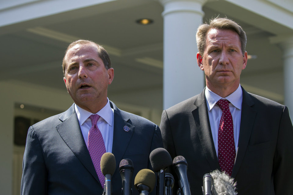 Photo -  Health and Human Services Secretary Alex Azar, left, and acting FDA Commissioner Ned Sharpless speak with reporters after a meeting about vaping with President Donald Trump in the Oval Office of the White House, Wednesday, Sept. 11, 2019, in Washington. (AP Photo/Alex Brandon)