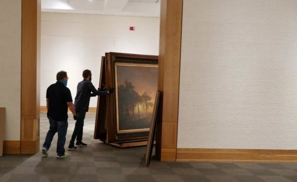 Photo - National Cowboy Museum employees take down one of the museum's signature works,