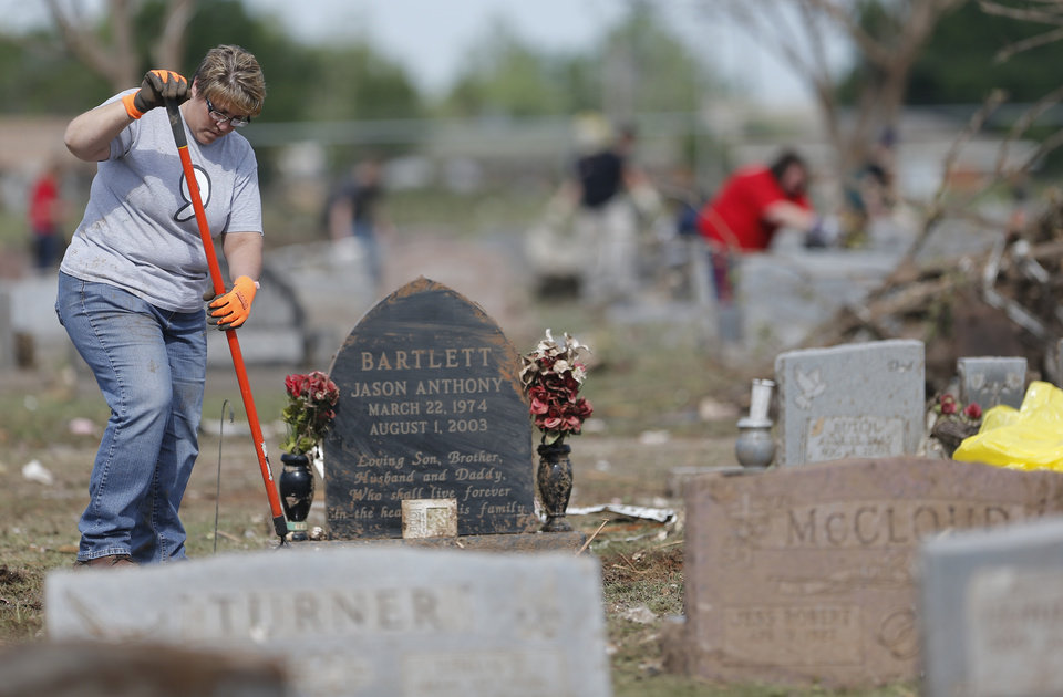 Photo - Toni Allison pauses as she cleans her nephew's grave stoneup a cemetery in Moore, Okla., Wednesday, May 22, 2013. Photo by Sarah Phipps, The Oklahoman