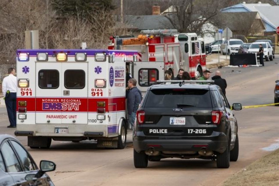 Photo -  Emergency crews respond to a scene where six Moore High School students were hit by a pickup in Moore, killing one..  [Chris Landsberger/The Oklahoman]