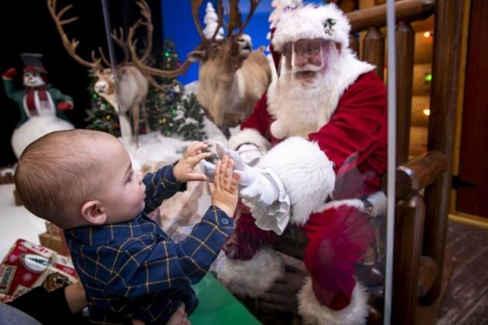 Photo -  Bass Pro Shops and Cabela's have reimagined their free Santa's Wonderland experience due to the pandemic, placing a glare-free acrylic protective barrier between St. Nick and visiting families, creating a contactless experience. [Photo provided]