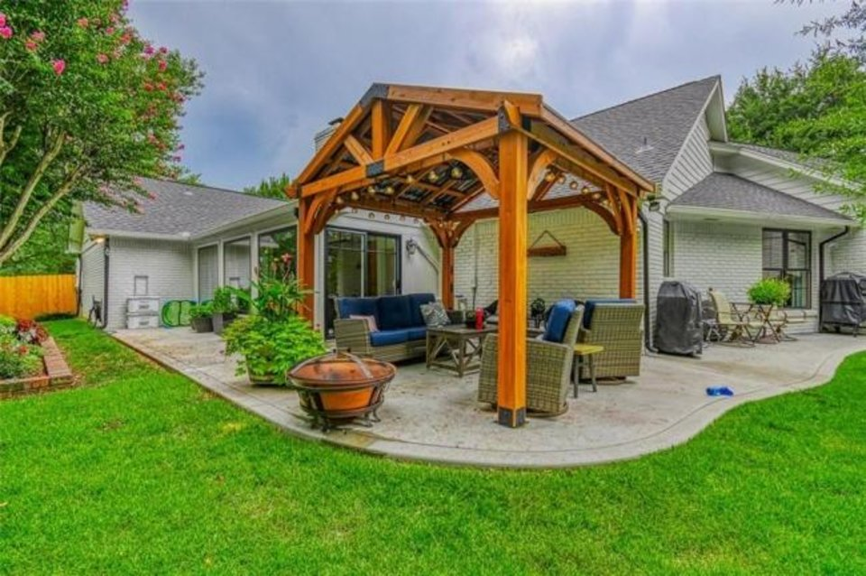Photo -  Backyard view with pergola at 2609 Barry Switzer Ave. in Norman, the Listing of the Week. [PHOTO PROVIDED]