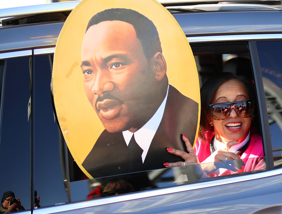 Photo - A woman in a car in the parade reacts to the crowd for the MLK Day Parade along Walker Ave. during celebrations of Dr. Martin Luther King, Jr. holiday, Monday, January 20, 2019. [Photo by Doug Hoke/The Oklahoman]