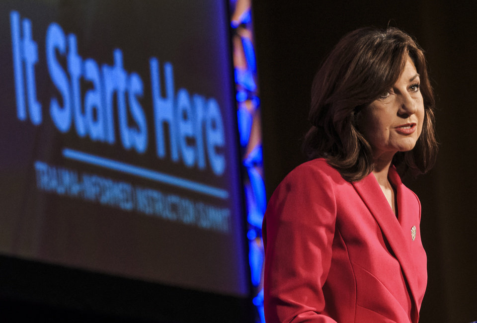 Photo -  State schools Superintendent Joy Hofmeister speaks during the