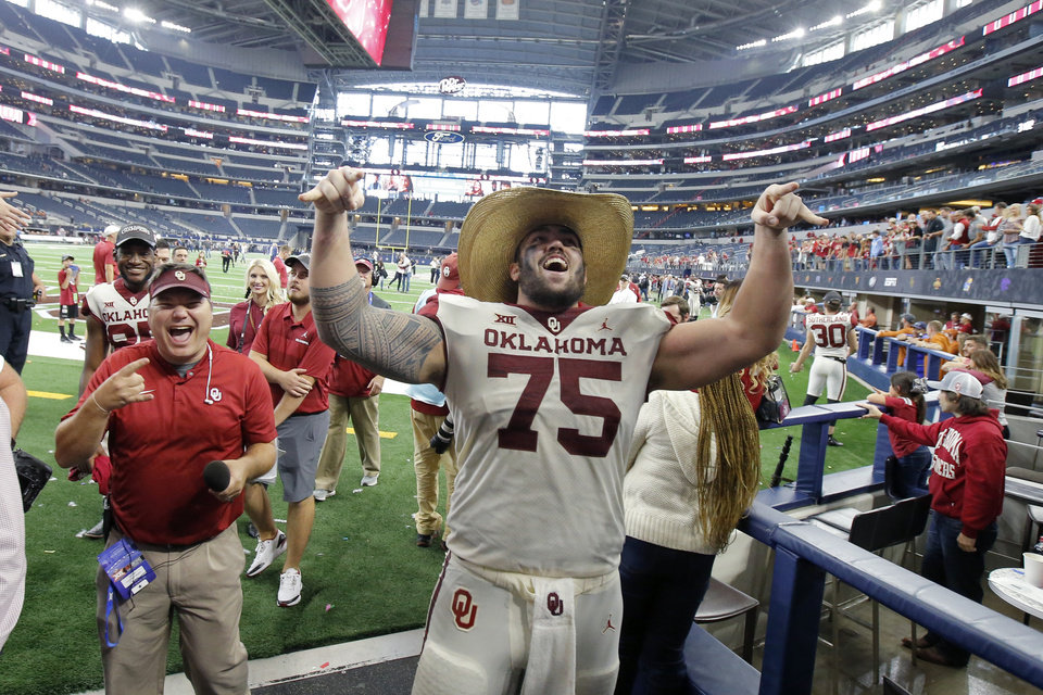 Photo - Oklahoma's Dru Samia (75) celebrates after the Big 12 Championship football game between the Oklahoma Sooners (OU) and the Texas Longhorns (UT) at AT&T Stadium in Arlington, Texas, Saturday, Dec. 1, 2018.  Oklahoma won 39-27. Photo by Bryan Terry, The Oklahoman